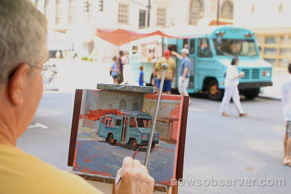 Photo from Raleigh News & Observer showing Doug working on painting 2