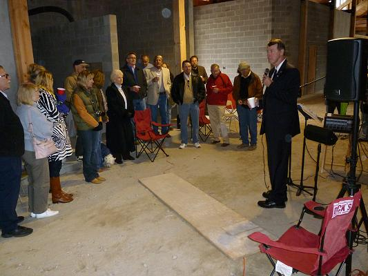 Congressman Etheridge speaking to some of the hikers, bidders, and artists