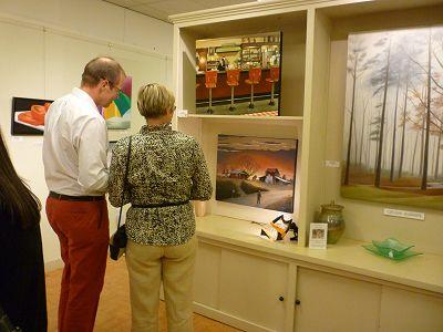Gallery visitors ponder 2 of Doug's paintings