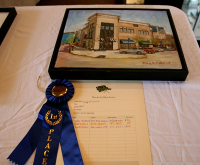 Doug's winning quick painting entry recieves bids during the silent auction.